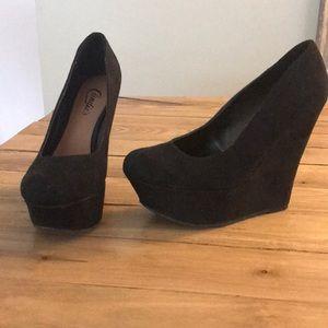 Black suede wedge heels